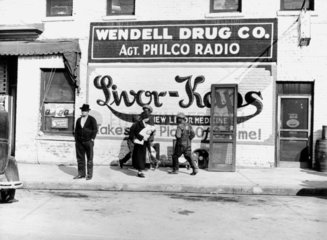 Advertisement on the side of a drugstore  North Carolina  1939.