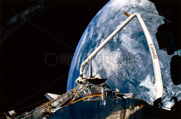 Space Shuttle Discovery and robot arm  1990.
