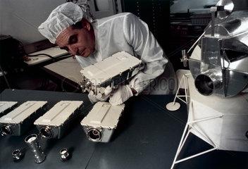Technician assembling Apollo 9 television cameras  1969.