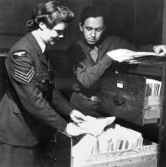 Military personnel looking through files  1