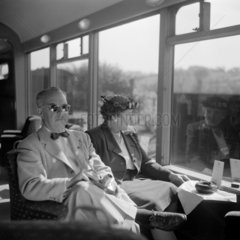 Two American tourists travelling to Devon on the 'Devon Belle'  May 1950.