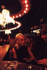 Woman sitting at the 'Honeymoon Hotel' bar  USA   c 1971.