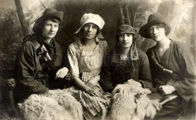 Four young women in fancy dress  1920s.