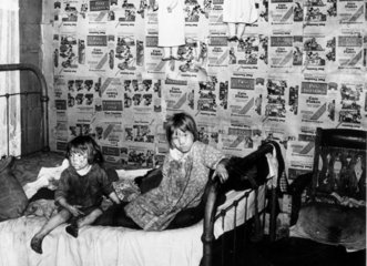 Children in the bedroom of their home  West Virginia  USA  September 1938.