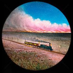 Prairie on fire with train  hand-coloured magic lantern slide  19th century.