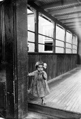 Small girl  USA  c 1910s.