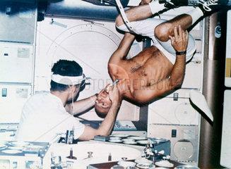 Oral inspection aboard Skylab  1973.
