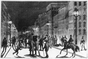 Street lit by Brush arc lamps  New York  USA  1881.