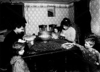'Italian family pick nutmeats'  New York  1911.