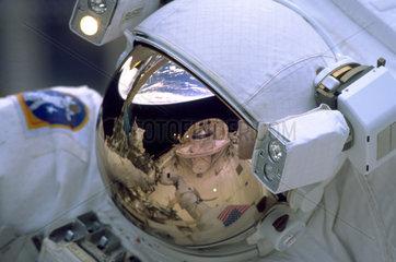 Astronaut spacewalking  1999.