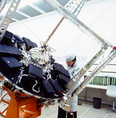 Geos satellite with technician  1960s.