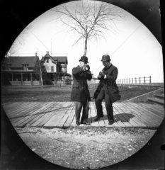 Two men in bowler hats  dancing  USA  c 189