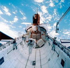 Shuttle astronaut with Solar Maximum Satellite  1984.