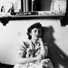 Woman listening to a murder mystery on the radio  Washington DC  USA  1943.
