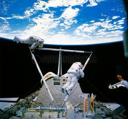 Shuttle astronauts on Extra Vehicular Activity (EVA)  1985.