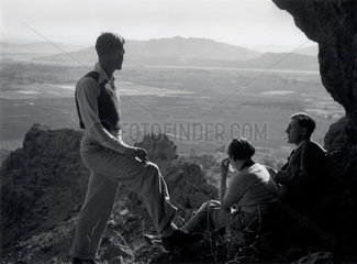 Three ramblers admiring the view  USA  c 1930s.