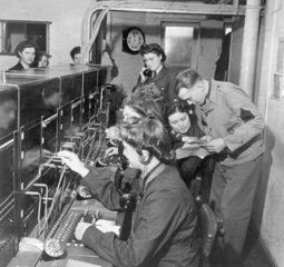 Women operating a switchboard  15 December