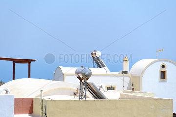 Solar hot water tank on a roof  Santorini island  Cyclades  Greece.