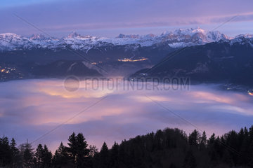 Stratus lit by Cluses in the setting sun and massif of Mont Blanc  Alpes  France