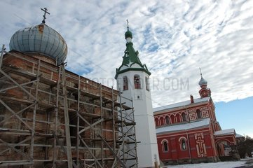 XIII century old church in restoration and red monastery