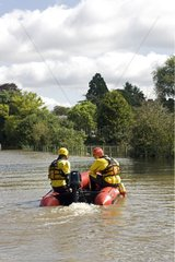 RSPCA rescue team in a dinghy Tewkesbury UK