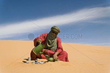 Tuareg preparing the traditional tea Gandoura Algeria