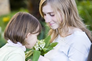 Lily of the Valley Girl feeling held by a teenage France
