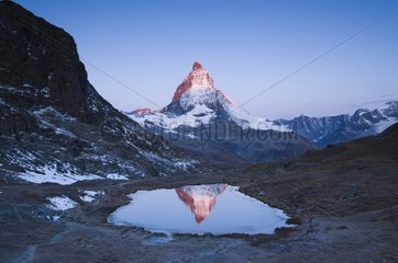 Matterhorn reflected in Riffelsee at sunrise Switzerland