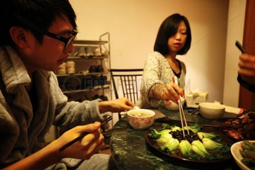 Couple enjoying a dish of sea cucumber China