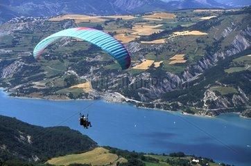 Paraglider flying over the lake of Serre-Ponçon