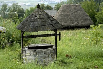 House and well with the thatched roofs Romania