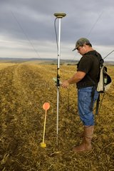 Surveying a field by a surveyor with a GPS
