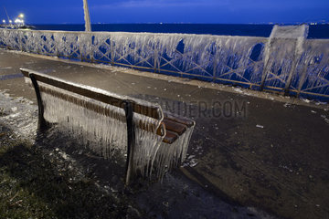 Bench and balustrade frozen in Evian  on the front of Lake Geneva  France