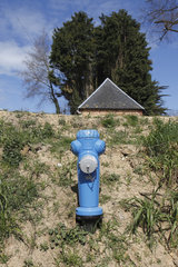 Fire-fighting reservoir with blue suction pole equipped with a dry fire safety device with visible plugs that enable an off-ground connection of the mobile fire-fighting equipment from a water reservoir in Senneville-sur-Fecamp  Normandy  France