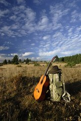 Backpack hat and guitar hiker Causse Méjan Cevennes France
