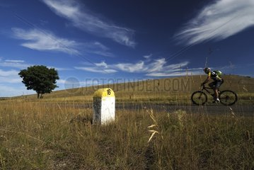 Cycling and milestone on the Causse Méjan Cevennes France
