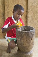 7 year old boy making chocolate from cocoa  Santana  Sao Tome and Principe Island