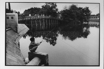 Young fisherman at Lake of the sword returned Hanoi Vietnam