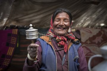 Woman with prayer wheel inside a Yack wool tent  Surroundings of Korzok  Leh  Ladakh  Himalayas  India