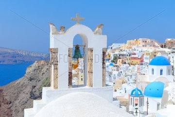 Village of Oia on the island of Santorini in the Cyclades  density of the habitat settled on a cliff on the caldera (caldera) contributing to the charm and tourist success of the village  Greece.