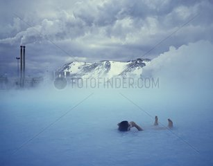 Man bathing in the blue Lagoon Iceland