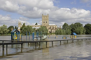 Chidren playground and flooded Tewkesbury Abbey UK