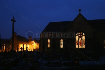 Lighted Norman village at evening Marcilly Manche France
