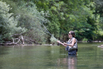 Woman fly fishing - River Albarine France