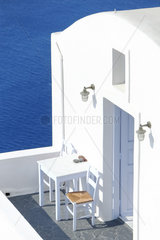 House with typical Cycladic architecture on the island of Santorini built on the volcanic cliff (caldera). Due to the low rainfall  the dwellings are not provided with tilesl. Oia  Greece.