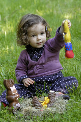 Girl and Easter chocolate in a nest - France