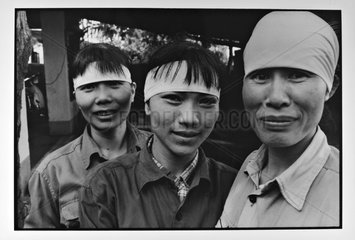 Portrait of smiling women miners Hongai in Vietnam