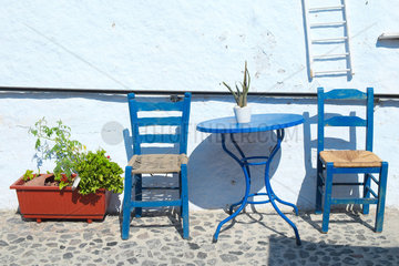 Table and Chairs  Atmosphere Cyclades  Village of Pyrogos  Santorini Island  Greece