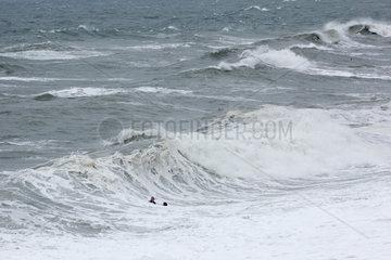 Dangerous bathing during a great tide in Etretat  Normandy  France