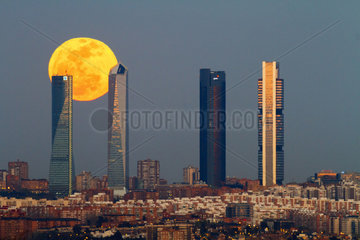 Full moon behind The four towers of Madrid - Spain
